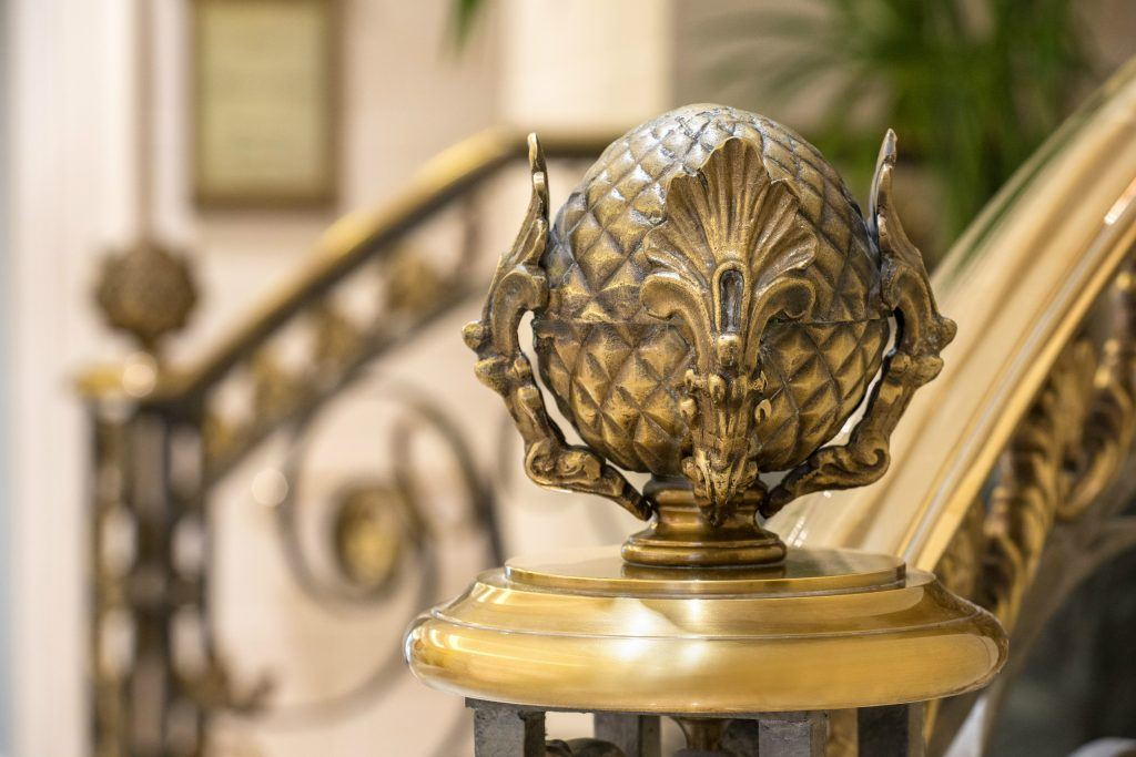 Balustrade handrail embellished with ornate metal tips, fully styled in a pine cone shape at the Hotel King George Athens
