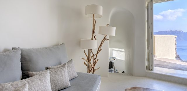 driftwood base floor lamp near sofa
