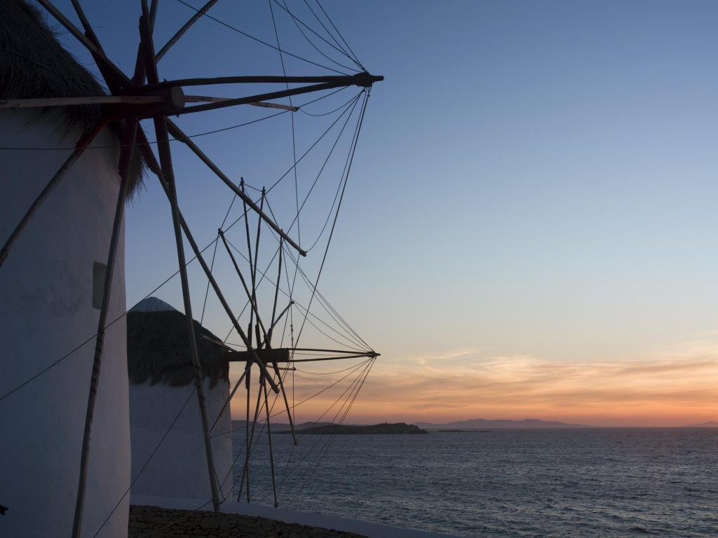 white windmills beside sea