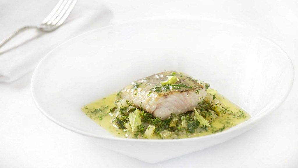 plate of fresh cod with leeks and celery