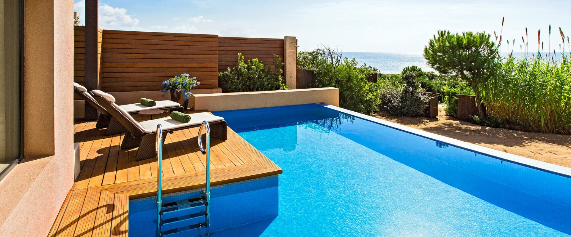 blue swimming pool beside concrete house