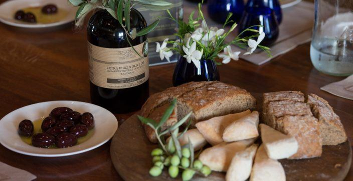 slice bread with berry and bottles on table