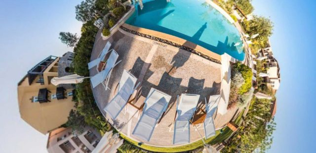 fish eye photography swimming pool beside sun loungers