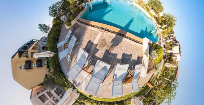 fish eye photography swimming pool beside sun loungers
