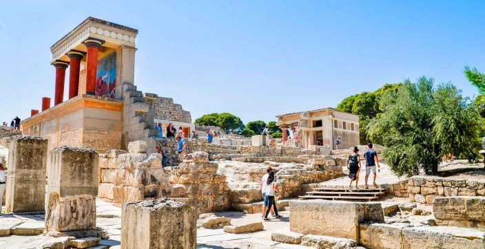 people walking on concrete ruins