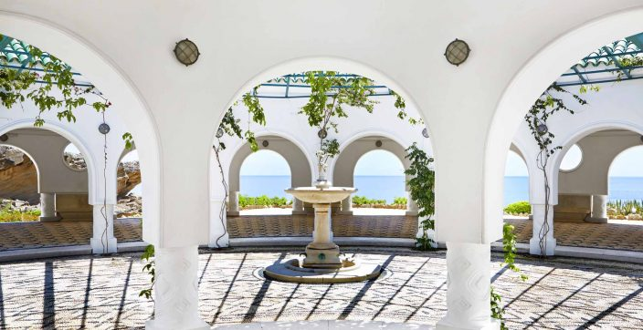 outdoor fountain surrounded by pillars