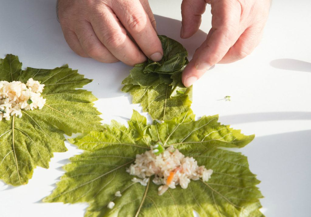 person making wrap leaf