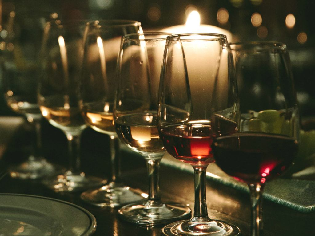 wine glasses beside votive candle