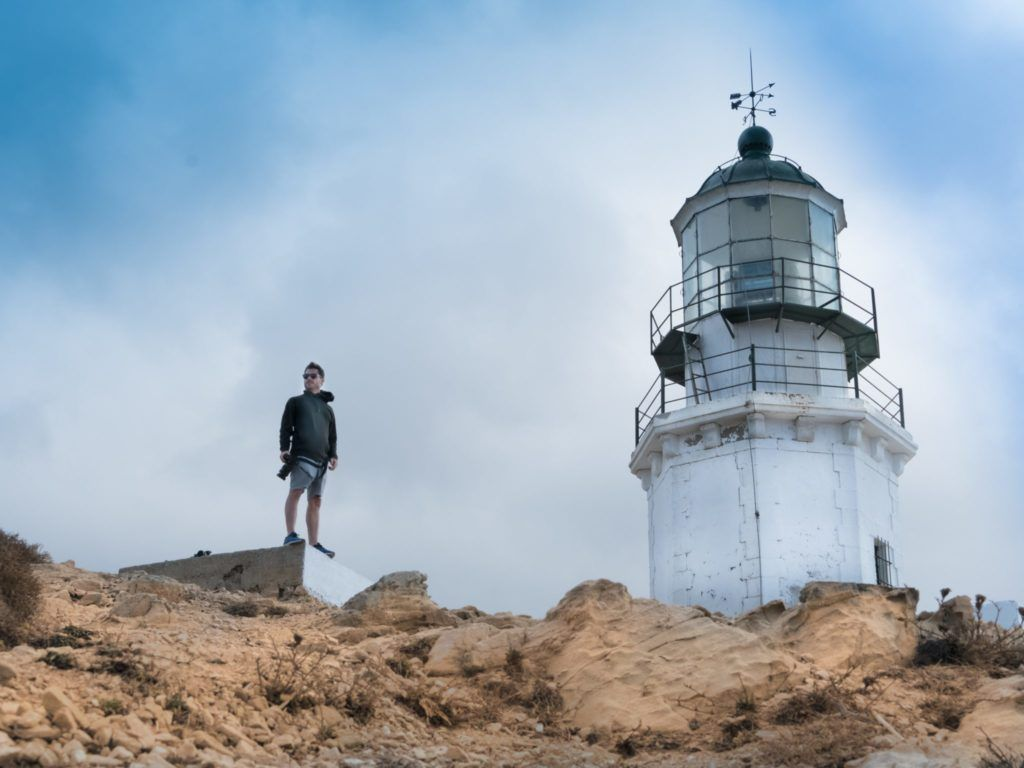 man standing near lighthouse